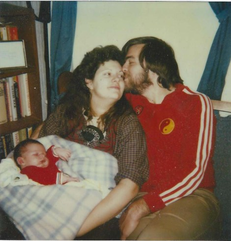 That's me as a baby. I broke records at the hospital when I popped out. 11.9 pounds and 23 inches according to the paperwork. Damn my mom was a superhero. Something depressing to add... this might be the only picture I have of just me and my parents in it.
